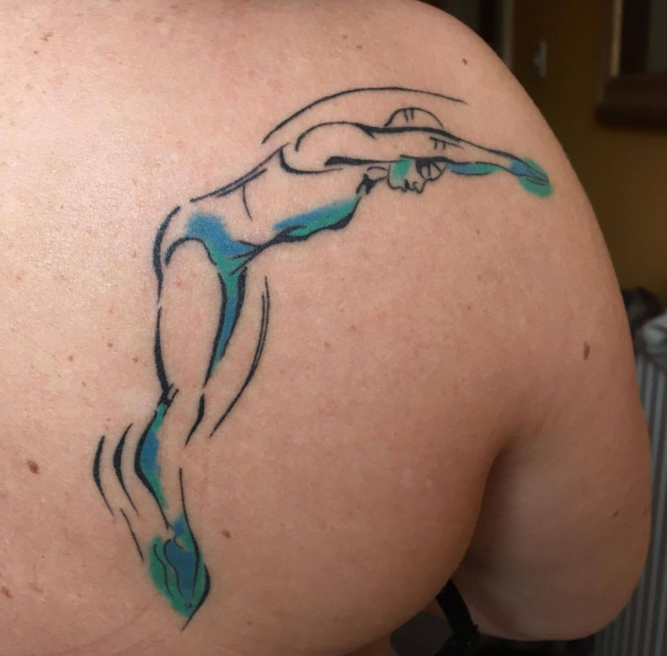 Emma's swimmer tattoo