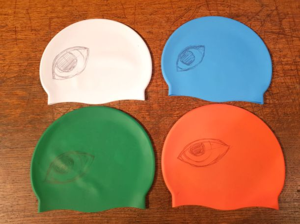 Working out the actual eye placement - this changed the design as the eye needed moving a lot from my original guess (orange hat) to the final (white hat)