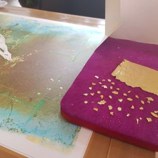 Adding more flakes of gold leaf afterwards (stuck with a tiny drop of gum arabic this time)